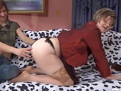 Russian Mature in minimal stockings with son
