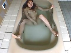 A Fifth Japanese Woman Enjoys Herself Underwater