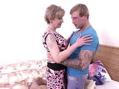 Chesty older dame Mili loves a blond boy's pretext endow with