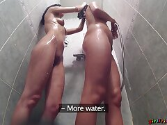 Naughty girls take a shower together and lick each other. HD