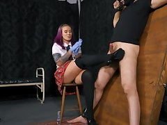 Schoolgirl with blue gloves plays with her boytoy