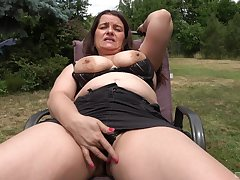 Auntie shows off anent the back yard, masturbating like a slut